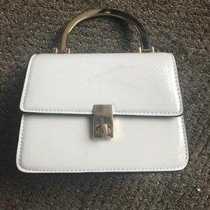 Mini Cream patent leather purse from Top Shop